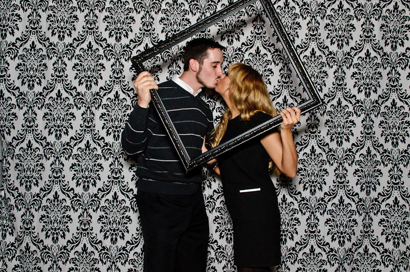 Kissing in Wedding Reception Photobooth