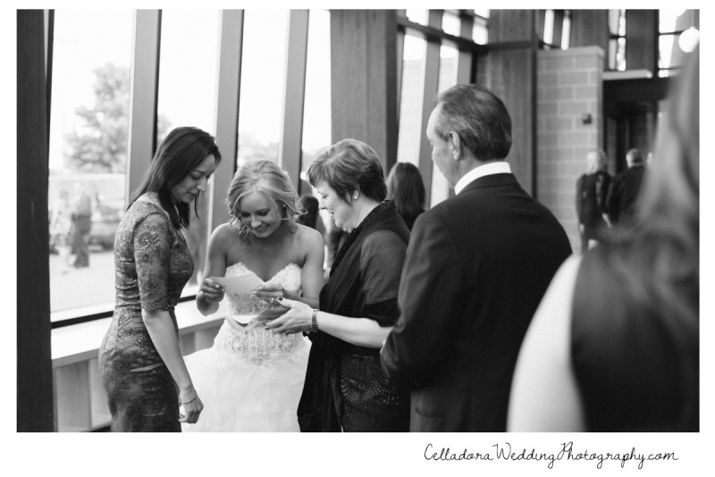 bride-looking-at-photobooth-prints-800x534 Nashville Wedding Photography | WO Smith Music School