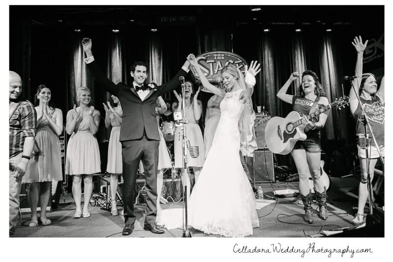 bride-and-groom-on-stage-broadway-800x534 John + Lindsay Downtown Nashville Wedding