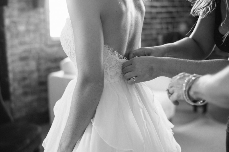 bride-getting-into-dress1-800x533 One Cannery Ballroom Nashville 4th of July Wedding | Brian and Jenna