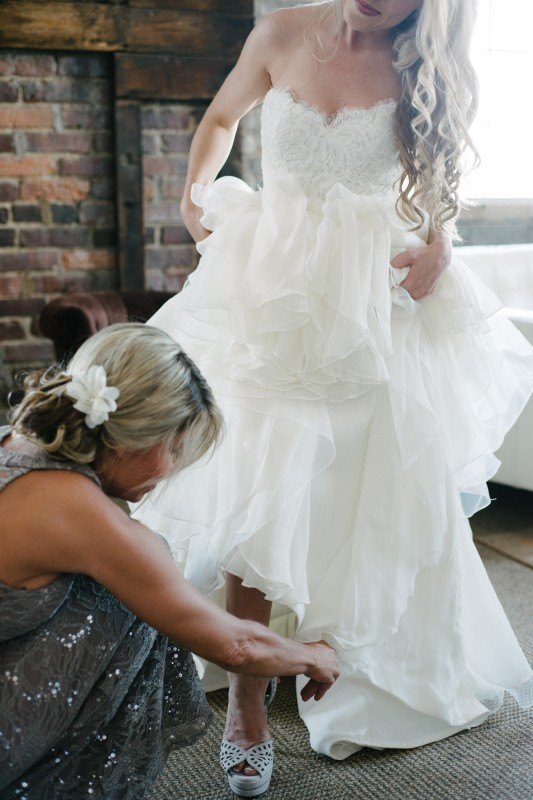 bride-getting-into-shoes-533x800 One Cannery Ballroom Nashville 4th of July Wedding | Brian and Jenna