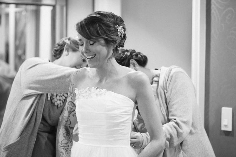 bridesmaids-helping-bride-into-dress1-800x533 Opryland Hotel Wedding in Nashville, TN - Dawn + Keith