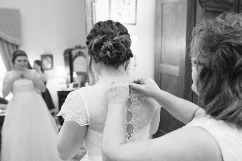 bride-getting-into-dress1-800x534 Two Rivers Mansion Fall Wedding | Kristen and Chris