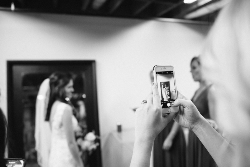 bridesmaid-phone-photographer-800x534 Kristen and Nick Wedding at aVenue | Nashville, TN