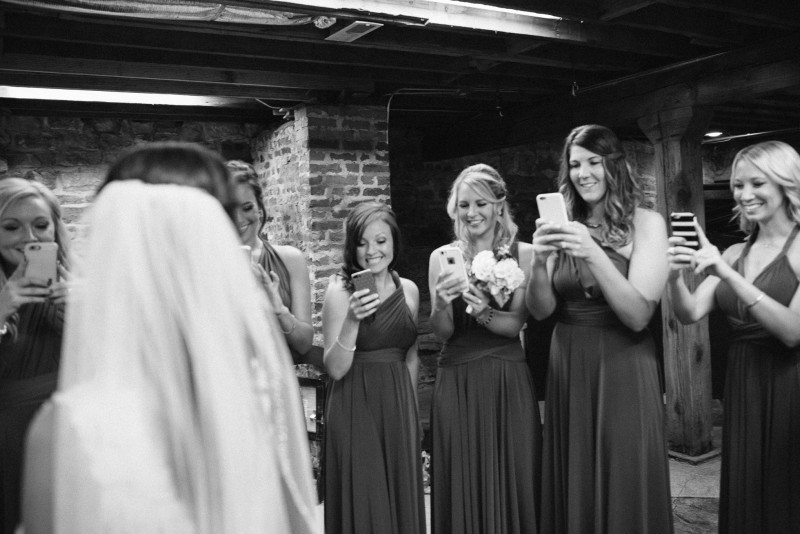 bridesmaids-taking-iphone-photos-800x534 Kristen and Nick Wedding at aVenue | Nashville, TN