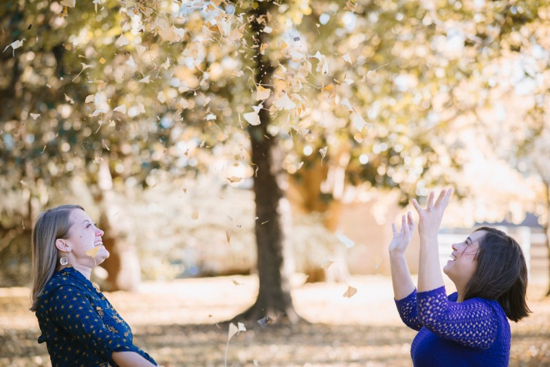 throwing-leaves-in-air-800x534 Amy + Tara Engagement Session | Nashville, TN