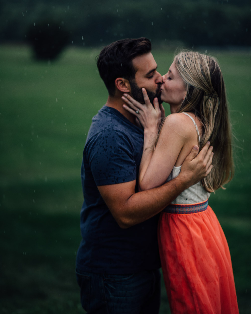 couple-kissing-in-rain Becky + Alexander's Epic Engagement Session