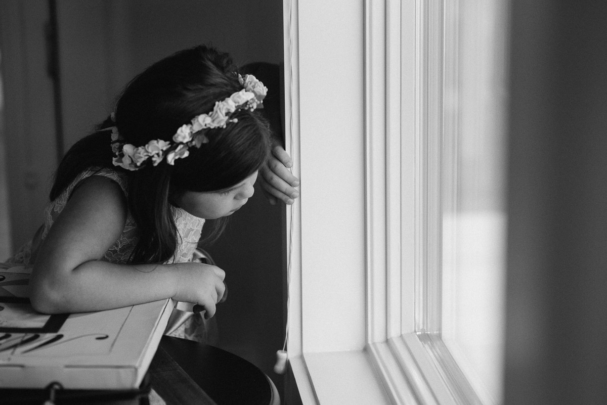 flower-girl-looking-out-window Destin Beach House | Destination Wedding | Kasey and Rocky