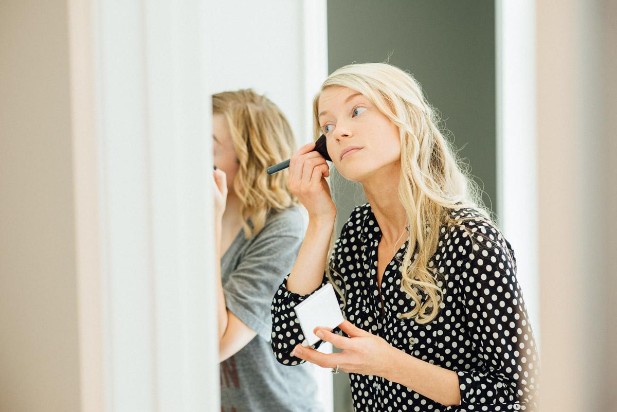 bride-doing-makeup Becky and Alex | Green Door Gourmet - Fall Nashville Wedding