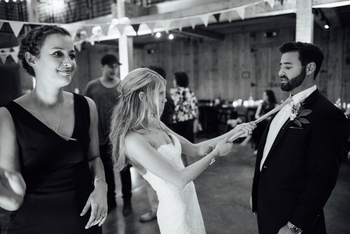 bride-pulling-grooms-tie Becky and Alex | Green Door Gourmet - Fall Nashville Wedding