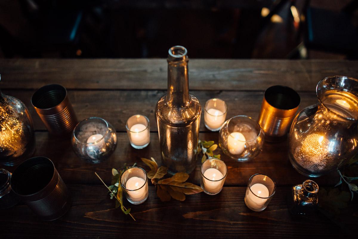 candles-and-bottles-centerpieces Becky and Alex | Green Door Gourmet - Fall Nashville Wedding