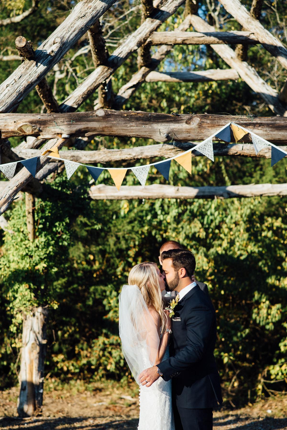 first-kiss Becky and Alex | Green Door Gourmet - Fall Nashville Wedding