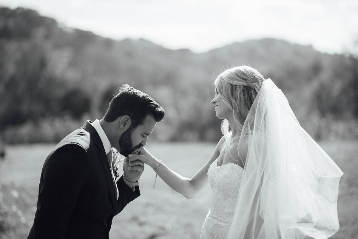 groom-kissing-brides-hand Becky and Alex | Green Door Gourmet - Fall Nashville Wedding