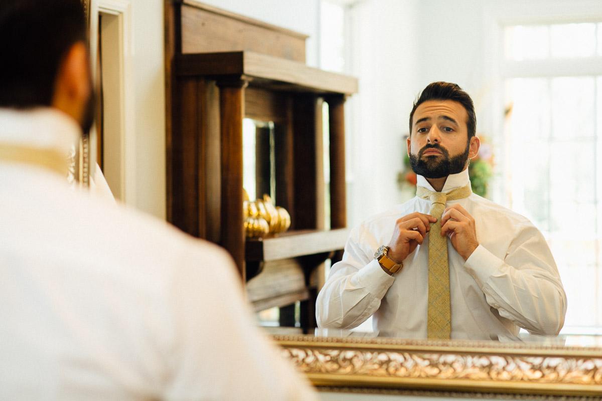 groom-tying-tie Becky and Alex | Green Door Gourmet - Fall Nashville Wedding