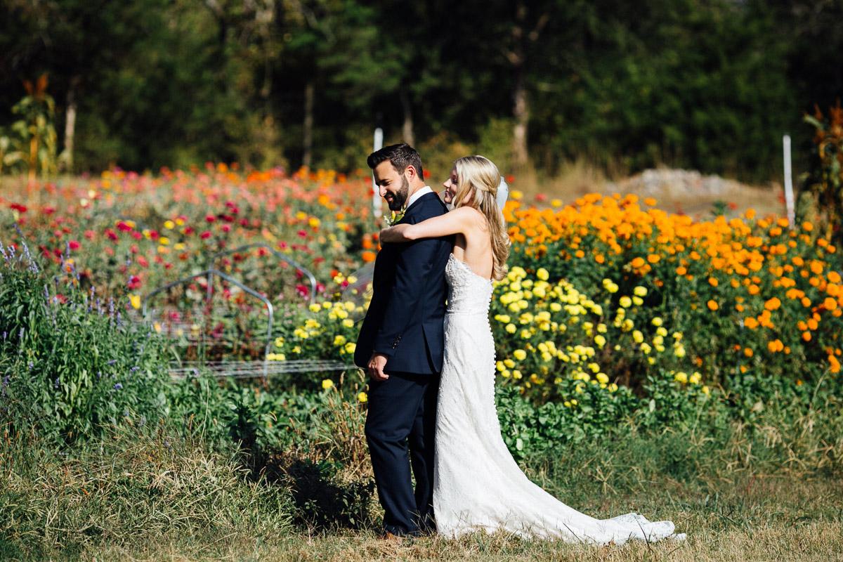 hug-from-behind Becky and Alex | Green Door Gourmet - Fall Nashville Wedding
