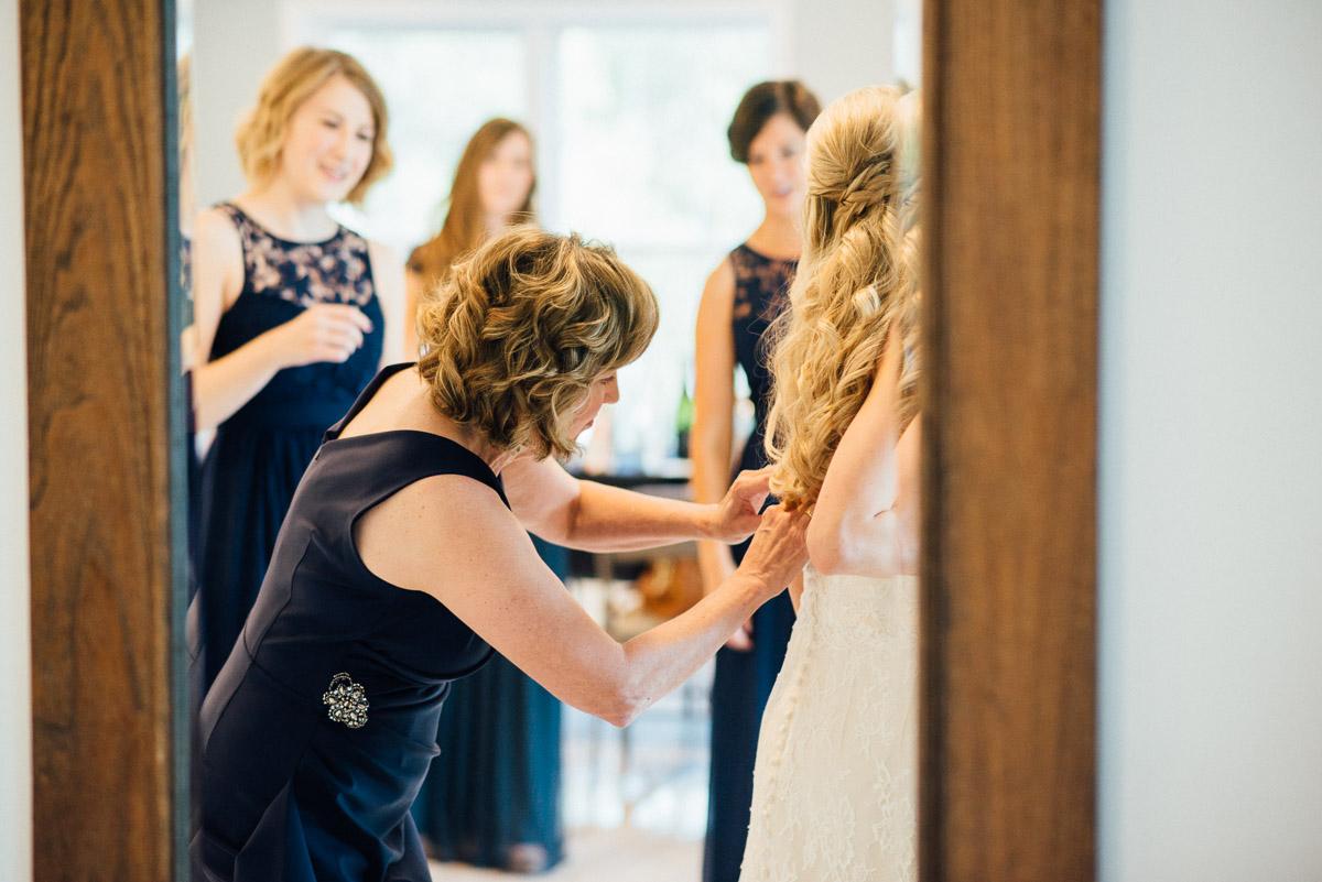 mother-helping-bride-into-dress Becky and Alex | Green Door Gourmet - Fall Nashville Wedding